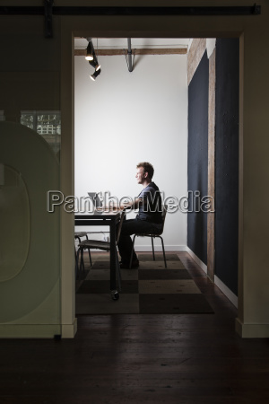 caucasian male worker using a laptop