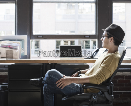 hispanic male at his office workstation