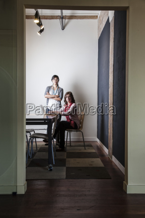 caucasian woman and asian woman working