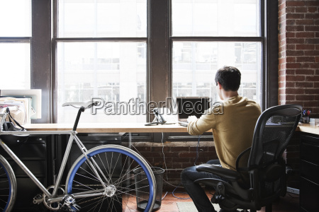 hispanic man at his office workstation