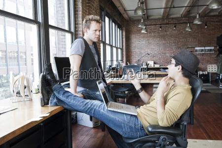 caucasian man and hispanic man discussing