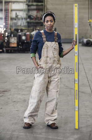black woman factory worker standing on