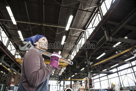 black woman factory worker holding a