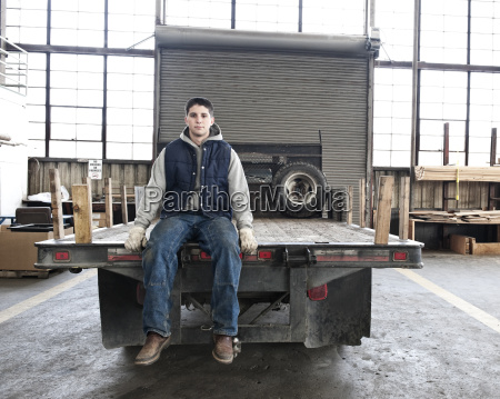 a young caucasian factory worker sitting
