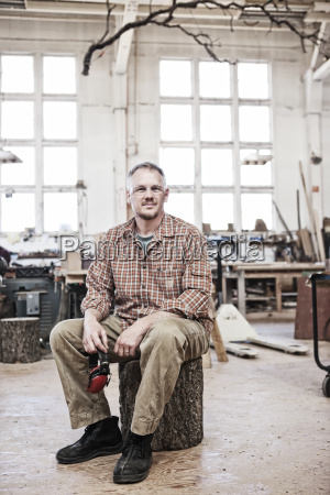 caucasian man factory worker sitting on