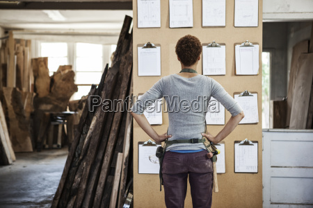 woman factory worker checking project inventory
