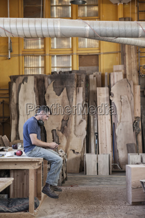 caucasian man factory worker taking a