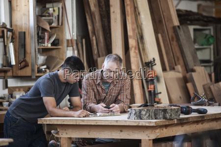 team of two caucasian men factory