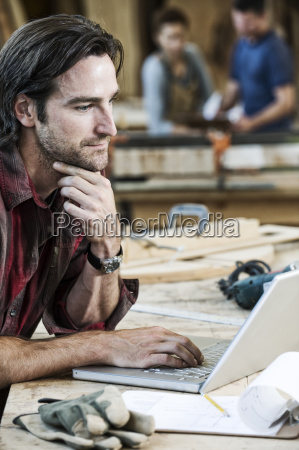 caucasian man factory worker working on