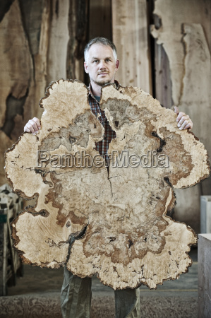 caucasian man factory worker holding a