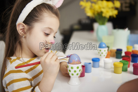 girl with bunny ears sitting at