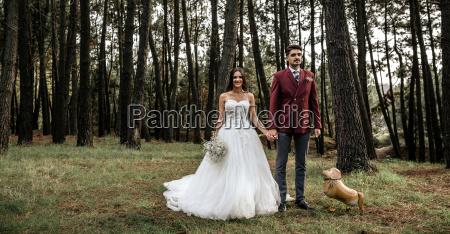 happy bride and groom standing in