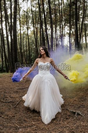 woman wearing wedding dress in forest