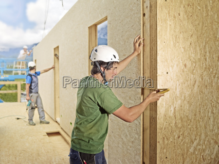 austria worker checking flakeboard with pocket