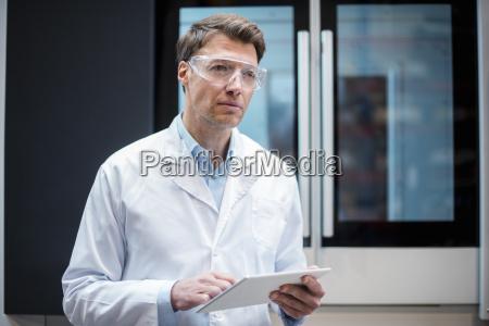 portrait of man wearing lab coat