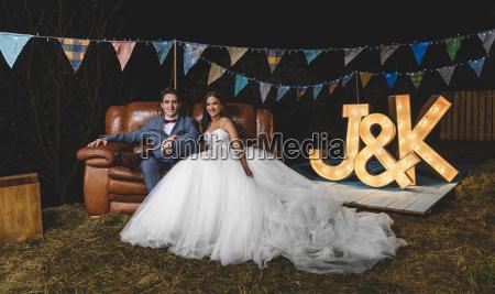 portrait of happy wedding couple sitting