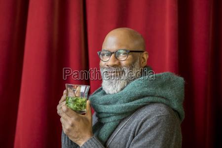 portrait of happy man with glass