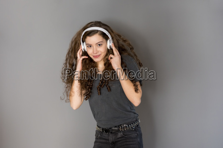 portrait of teenage girl with curly