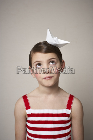 portrait of little girl with paper