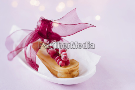 mini cheese cake garnished with red
