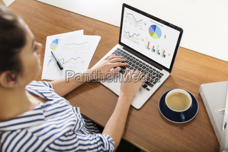 young woman working on charts on