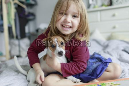 portrait of happy little girl crouching