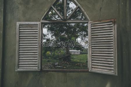 cuba window in a wall looking