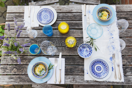 garden table laid with colorful plates