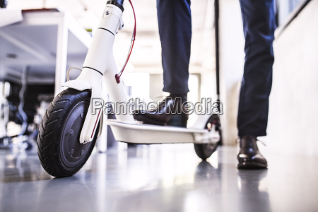 close up of businessman with scooter