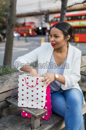 uk london woman with shopping bags