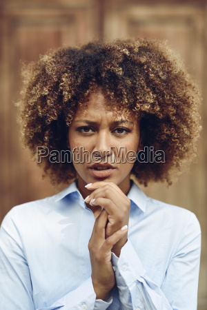 portrait of serious woman with afro