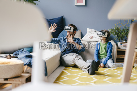 father and son wearing vr glasses