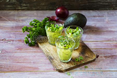 glasses of avocado cream with chili
