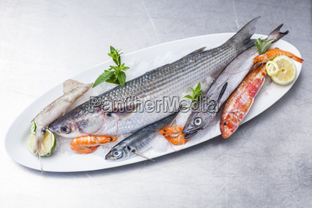 platter with raw fish and seafood
