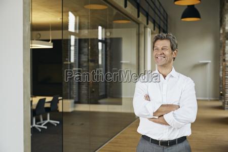 portrait of smiling businessman in modern