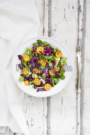 mixed salad with kumquat red cabbage
