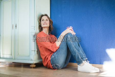 relaxed woman sitting on the floor