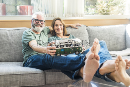 happy mature couple on couch at