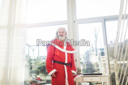 smiling bearded mature man wearing santa