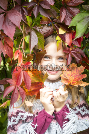 portrait of happy girl hiding behind