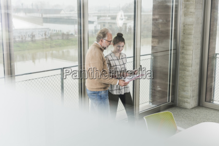 casual mature businessman and young woman
