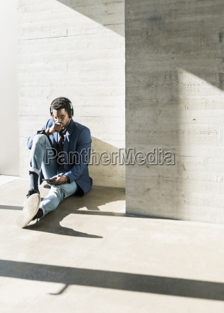businessman sitting on the floor in