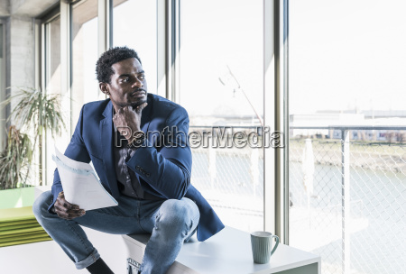 businessman with papers sitting at the