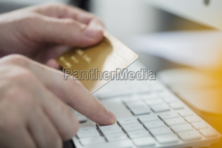 man making online payment with credit