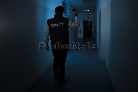 security guard standing in corridor of