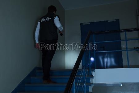 security guard walking on stairway