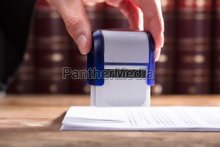 judge stamping document
