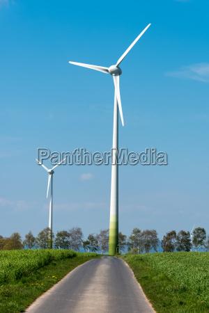 wind turbines and asphalt road seen