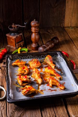 rustic backed chicken wings legs on