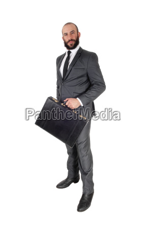 business man holding his briefcase standing